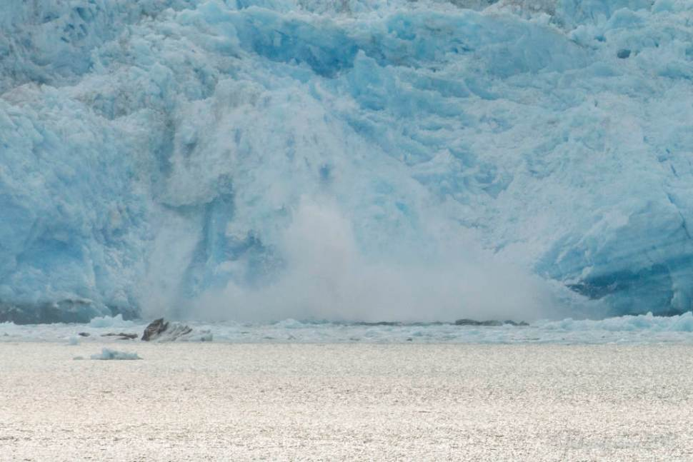 Calving glacier: the moment of impact with the water below