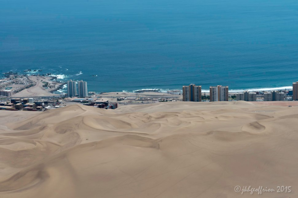 Sand dune rising over 2,500 feet in the middle of Iquique, Chile