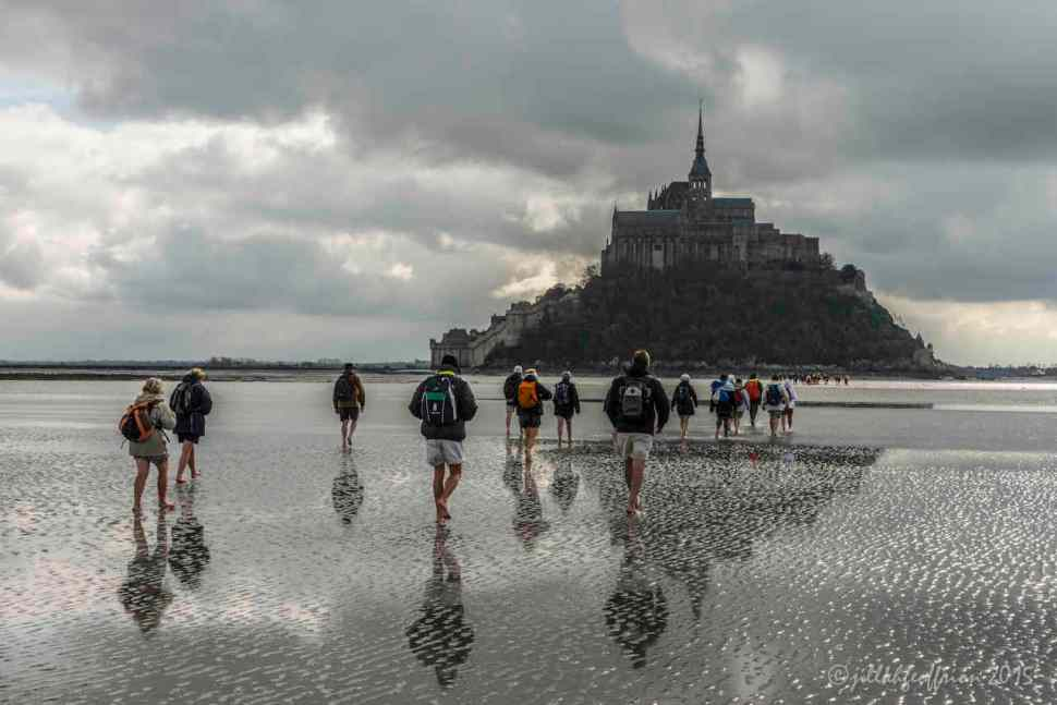 Pilgrims walk across the Baie of Mont Saint Michel by Jill K H Geoffrion