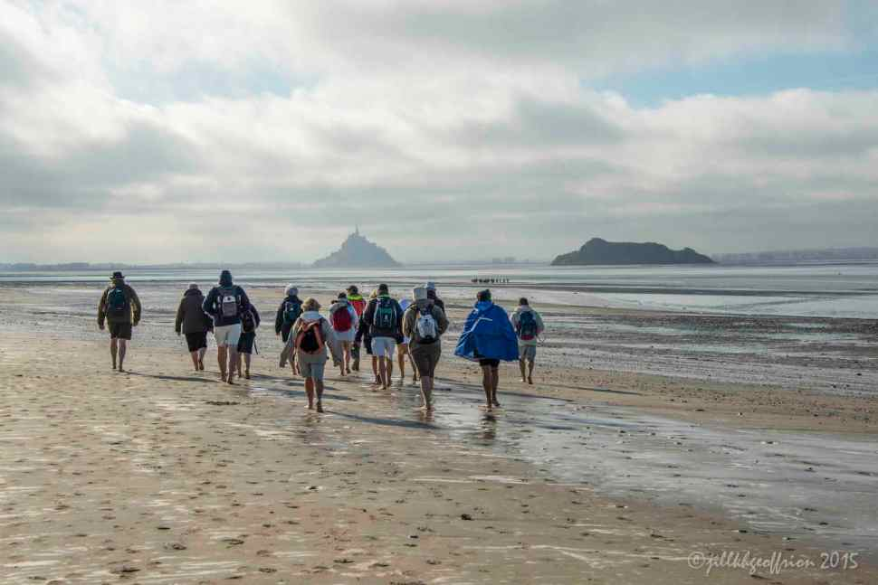 Pilgrims walk across the Baie of Mont Saint Michel by Jill K H Geoffrion