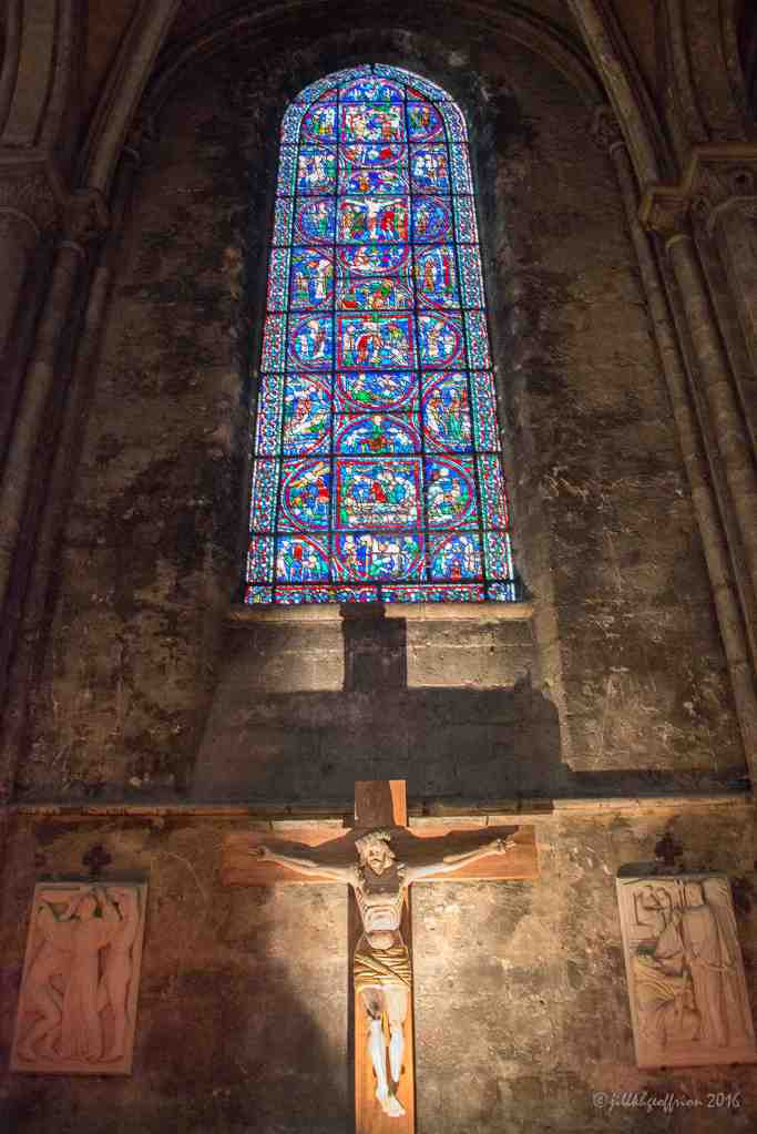 The Passion Window and a Crucifix by Jill K H Geoffrion