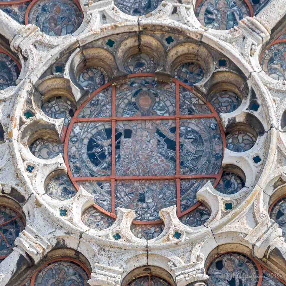 Jesus in the center of the Chartres West Rose window by Jill K H Geoffrion