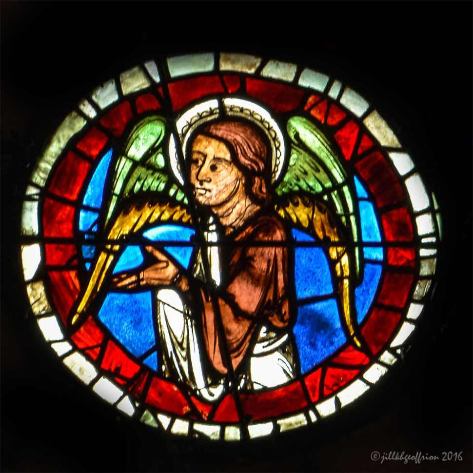 Angel of the west rose window at Chartres by Jill K H Geoffrion